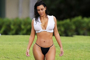 Kim Kardashian'dan cüretkar plaj stili!